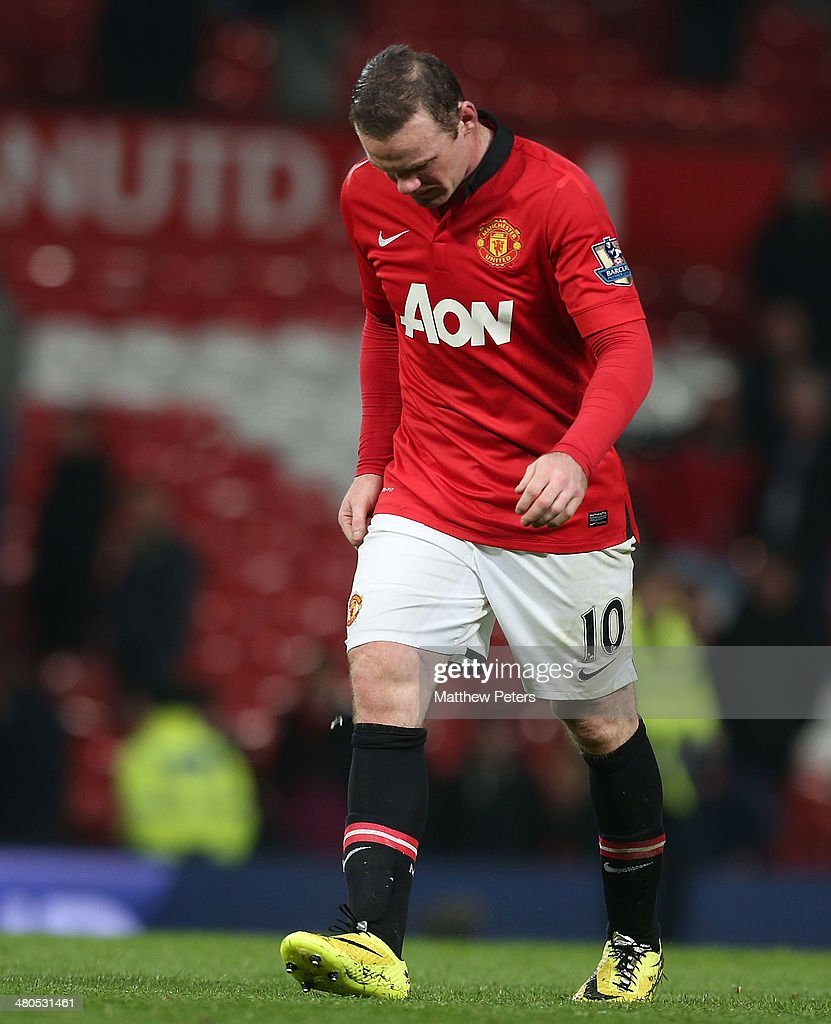 Wayne Rooney of Manchester United walks off after the Barclays Premier League match between Manchester United and Manchester City at Old Trafford on March 25, 2014 in Manchester, England.