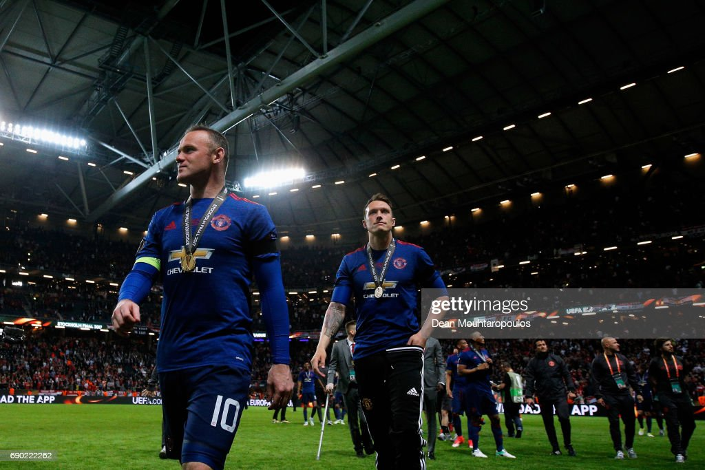 Wayne Rooney of Manchester United walks off the pitch with his winners medal after the UEFA Europa League Final between Ajax and Manchester United at Friends Arena on May 24, 2017 in Stockholm, Sweden.
