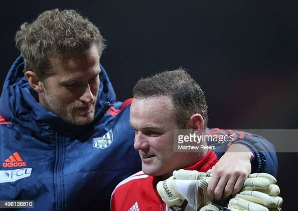 Wayne Rooney of Manchester United walks off with Anders Lindegaard of West Bromwich Albion after the Barclays Premier League match between Manchester...