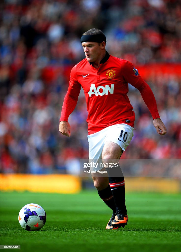 Wayne Rooney of Manchester United wears protective headwear during the Barclays Premier League match between Manchester United and Crystal Palace at Old Trafford on September 14, 2013 in Manchester, England.