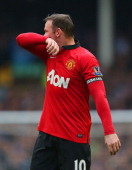 Wayne Rooney of Manchester United wears the Captain's armband during the Barclays Premier League match between Everton and Manchester United at...