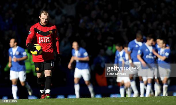 Wayne Rooney of Manchester waits to kick off as Everton celebrate their second goal during the Barclays Premiership match between Everton and...