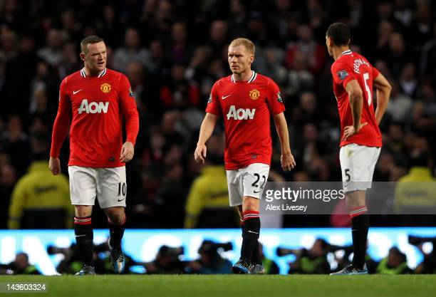 Wayne Rooney Paul Scholes and Rio Ferdinand of Manchester United react after conceding the opening goal during the Barclays Premier League match...
