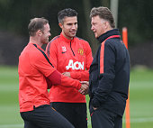Wayne Rooney Robin van Persie and Manager Louis van Gaal of Manchester United in action during a first team training session at Aon Training Complex...