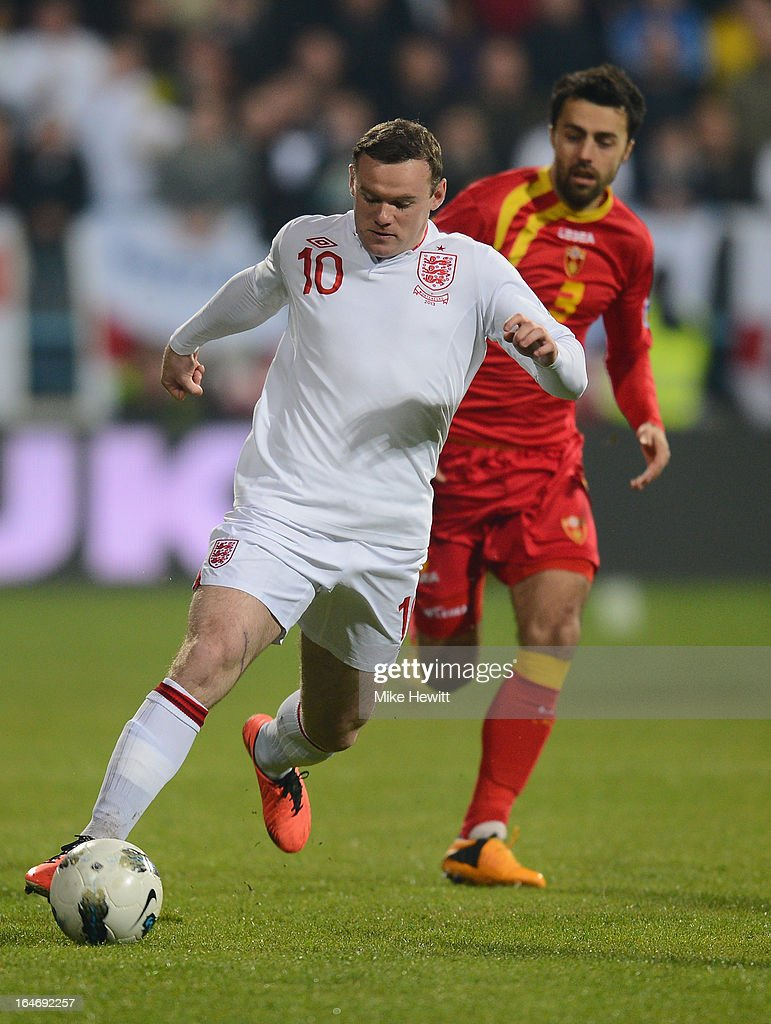 Wayne Rooney runs with the ball during the FIFA 2014 World Cup Group H Qualifier between Montenegro and England at City Stadium on March 26, 2013 in Podgorica, Montenegro.