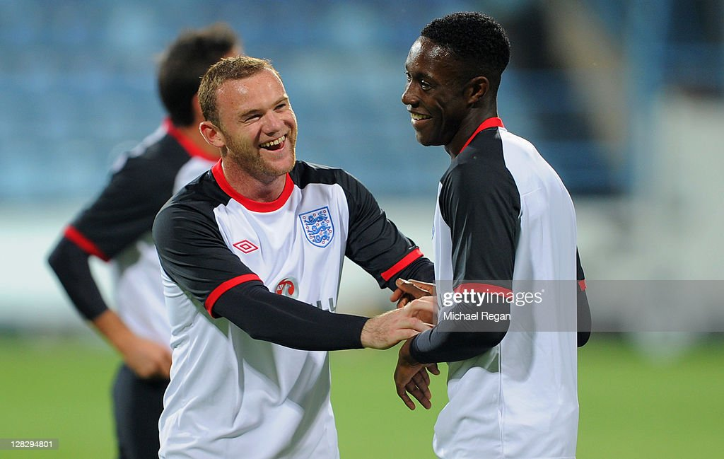 <a gi-track='captionPersonalityLinkClicked' href=/galleries/search?phrase=Wayne+Rooney&family=editorial&specificpeople=157598 ng-click='$event.stopPropagation()'>Wayne Rooney</a> shares a joke with Daniel Welbeck during the England training session ahead of their UEFA EURO 2012 Group G qualifier against Montenegro at Gradski Stadium on October 6, 2011 in Podgorica, Montenegro.