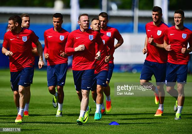 Wayne Rooney warms up with team mates during an England training session ahead of the UEFA EURO 2016 at Stade du Bourgognes on June 7 2016 in...