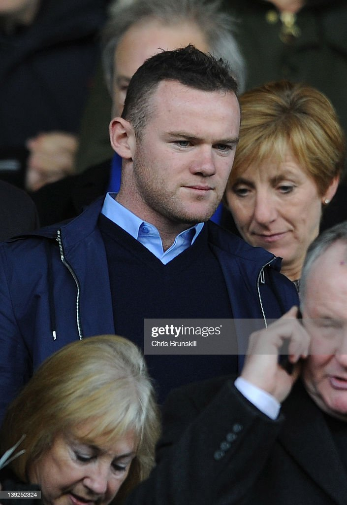 Wayne Rooney watches the action from the stands during the FA Cup Fifth Round match between Everton and Blackpool at Goodison Park on February 18, 2012 in Liverpool, England.