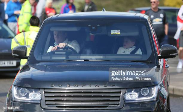 Wayne Rooney with son Kai arrives in his car before Michael Carrick's Testimonial match