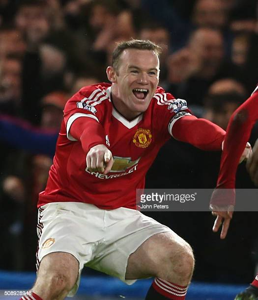 Wayne Rooneyof Manchester United celebrates Jesse Lingard scoring their first goal during the Barclays Premier League match between Chelsea and...