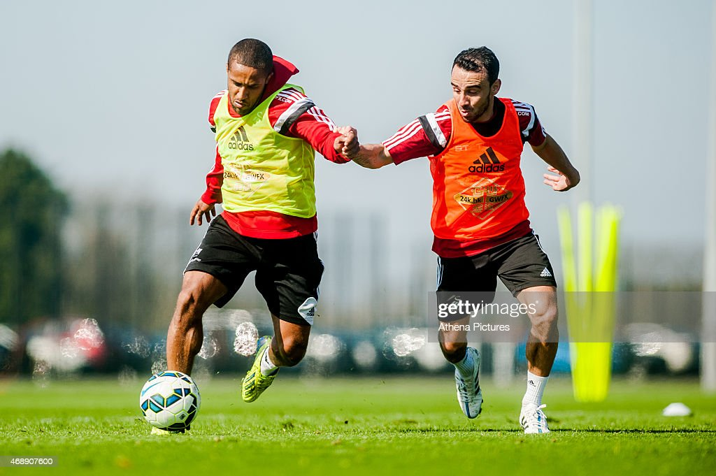<a gi-track='captionPersonalityLinkClicked' href=/galleries/search?phrase=Wayne+Routledge&family=editorial&specificpeople=206672 ng-click='$event.stopPropagation()'>Wayne Routledge</a> and <a gi-track='captionPersonalityLinkClicked' href=/galleries/search?phrase=Leon+Britton+-+Soccer+Player&family=editorial&specificpeople=12884689 ng-click='$event.stopPropagation()'>Leon Britton</a> of Swansea City in action during the Swansea City training session at the Fairwood Training Centre on April 07, 2015 in Swansea, Wales.