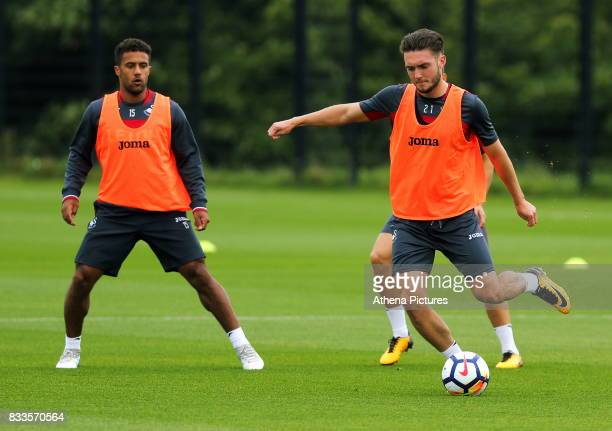 Wayne Routledge and Matthew Grimes in action during the Swansea City Training at The Fairwood Training Ground on August 16 2017 in Swansea Wales