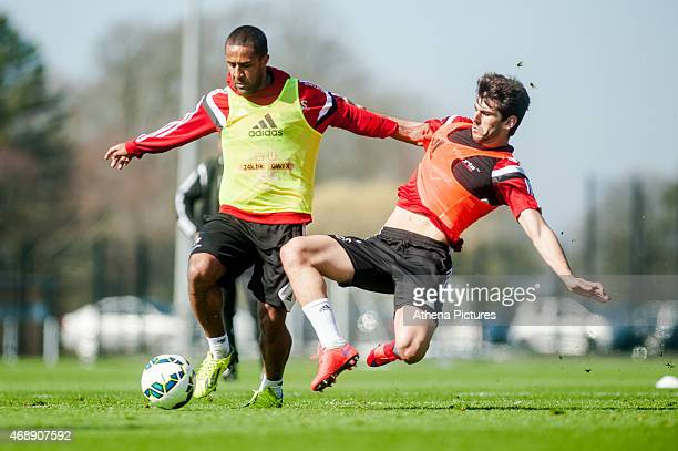 Wayne Routledge is challenged by Nelson Oliveira during the Swansea City training session at the Fairwood Training Centre on April 07 2015 in Swansea...
