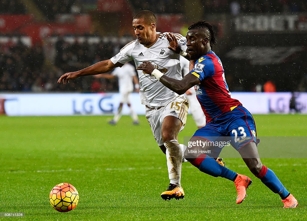 Wayne Routledge of Swansea City and Pape N'Diaye Souare of Crystal Palace compete for the ball during the Barclays Premier League match between Swansea City and Crystal Palace at the Liberty Stadium on February 6, 2016 in Swansea, Wales.