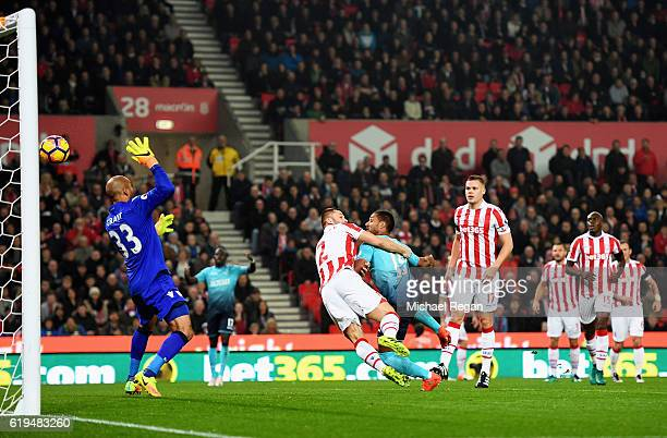 Wayne Routledge of Swansea City beats Phil Bardsley of Stoke City to score their first goal past goalkeeper Lee Grant of Stoke City during the...
