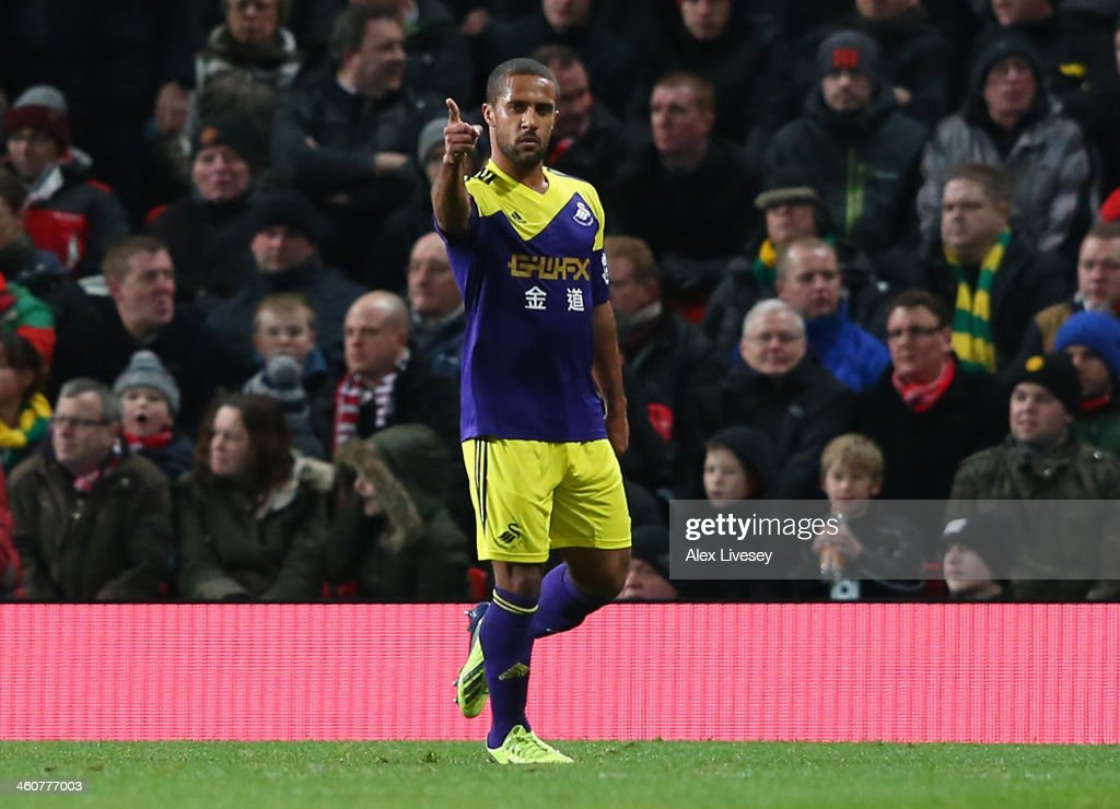 <a gi-track='captionPersonalityLinkClicked' href=/galleries/search?phrase=Wayne+Routledge&family=editorial&specificpeople=206672 ng-click='$event.stopPropagation()'>Wayne Routledge</a> of Swansea City celebrates scoring the opening goal during the FA Cup with Budweiser Third round match between Manchester United and Swansea City at Old Trafford on January 5, 2014 in Manchester, England.