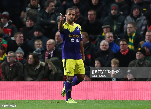Wayne Routledge of Swansea City celebrates scoring the opening goal during the FA Cup with Budweiser Third round match between Manchester United and...