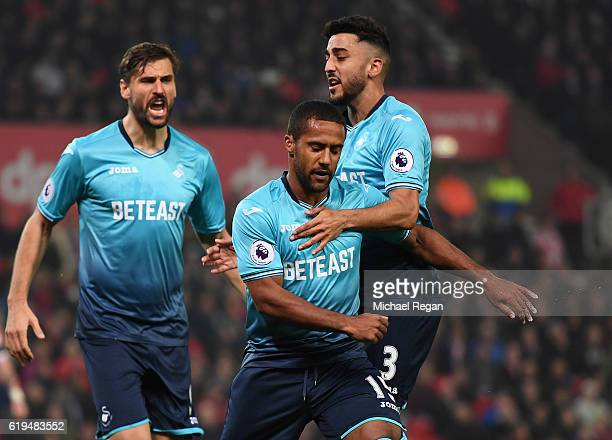 Wayne Routledge of Swansea City celebrates with Fernando Llorente and Neil Taylor as he to scores their first goal during the Premier League match...