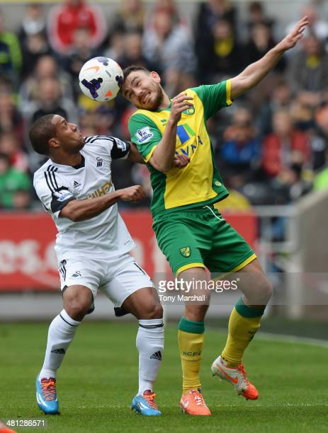 Wayne Routledge of Swansea City challenges Robert Snodgrass of Norwich City during the Barclays Premier League match between Swansea City and Norwich...
