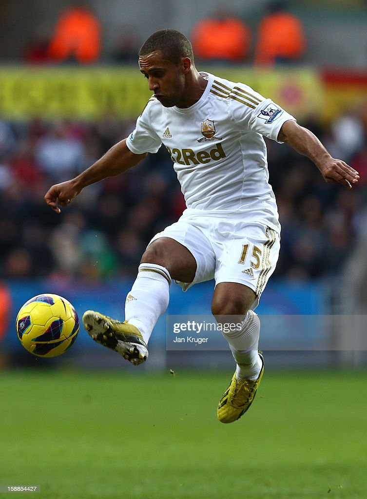 Wayne Routledge of Swansea City controls the ball during the Barclays Premier League match between Swansea City and Aston Villa at the Liberty Stadium on January 1, 2013 in Swansea, Wales.