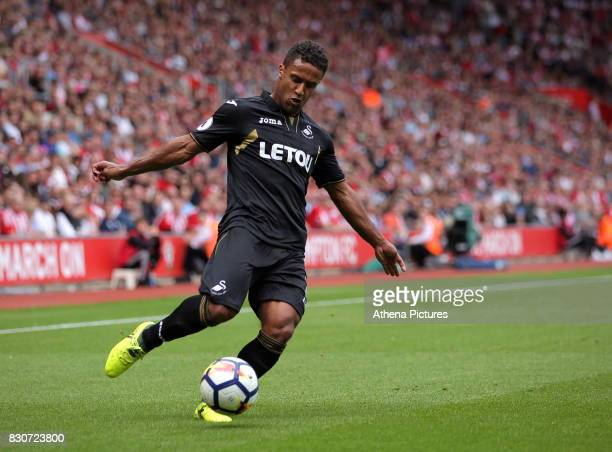 Wayne Routledge of Swansea City crosses the ball to team mate Tammy Abraham who headed the ball wide during the Premier League match between...