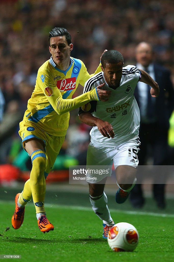 <a gi-track='captionPersonalityLinkClicked' href=/galleries/search?phrase=Wayne+Routledge&family=editorial&specificpeople=206672 ng-click='$event.stopPropagation()'>Wayne Routledge</a> (R) of Swansea City forces his way past Jose Callejon (L) of SSC Napoli during the UEFA Europa League Round of 32 First Leg match between Swansea City and SSC Napoli at the Liberty Stadium on February 20, 2014 in Swansea, Wales.