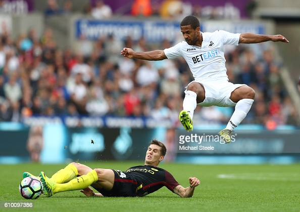 Wayne Routledge of Swansea City is fouled by John Stones of Manchester City during the Premier League match between Swansea City and Manchester City...