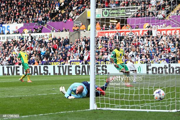 Wayne Routledge of Swansea City peels away after scoring his sides third goal as goalkeeperJohn Ruddy of Norwich City is beaten during the Barclays...