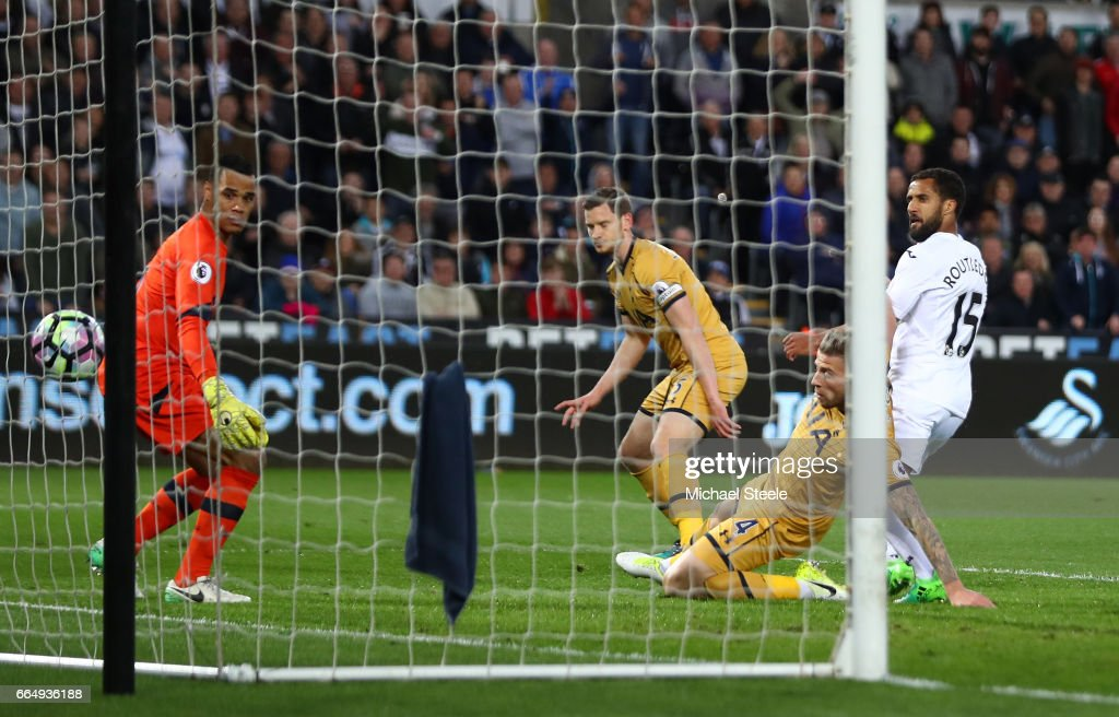 Wayne Routledge of Swansea City (R) scores his sides first goal during the Premier League match between Swansea City and Tottenham Hotspur at the Liberty Stadium on April 5, 2017 in Swansea, Wales.