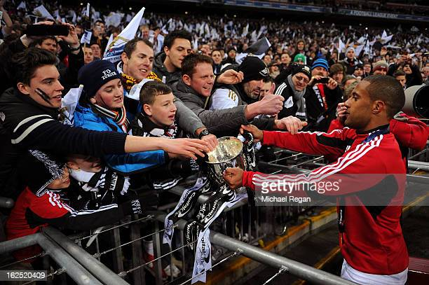 Wayne Routledge of Swansea City shows the cup to the fans during the Capital One Cup Final match between Bradford City and Swansea City at Wembley...