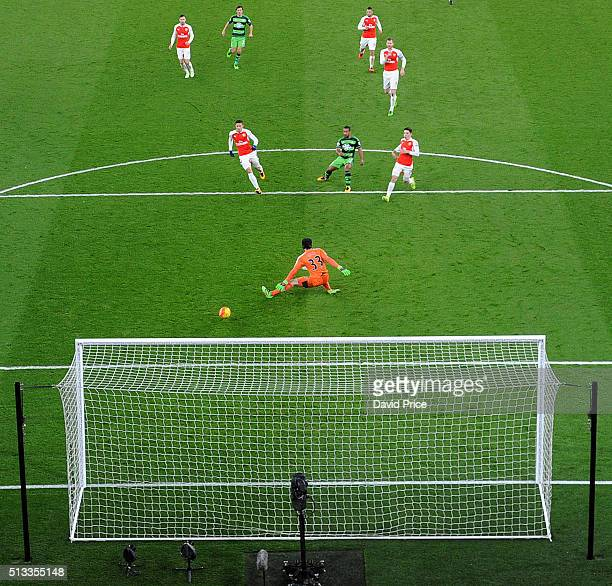 Wayne Routledge scores Swansea's 1st goal past Petr Cech of Arsenal during the Barclays Premier League match between Arsenal and Swansea City at...