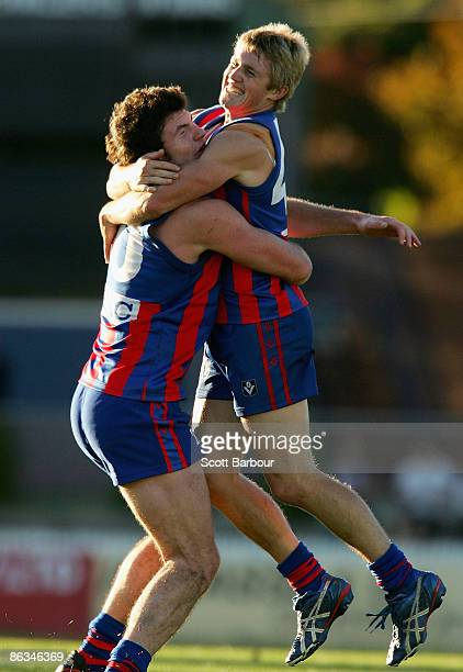 Wayne Schultz of Port Melbourne is congratulated by his team mate Toby Pinwill after kicking the winning goal during the round four VFL match between...