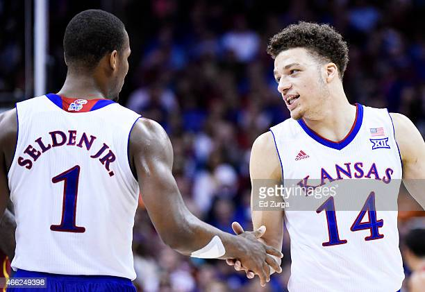 Wayne Selden Jr #1 and Brannen Greene of the Kansas Jayhawks react in the first half against the Iowa State Cyclones during the championship game of...