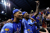 Wayne Selden Jr #1 and Jamari Traylor of the Kansas Jayhawks celebrate after defeating the Texas Tech Red Raiders 6758 to clinch its 12th straight...
