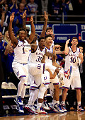 Wayne Selden Jr #1 Jamari Traylor Kelly Oubre Jr #12 and Sviatoslav Mykhailiuk of the Kansas Jayhawks celebrate while watching from the bench as Evan...