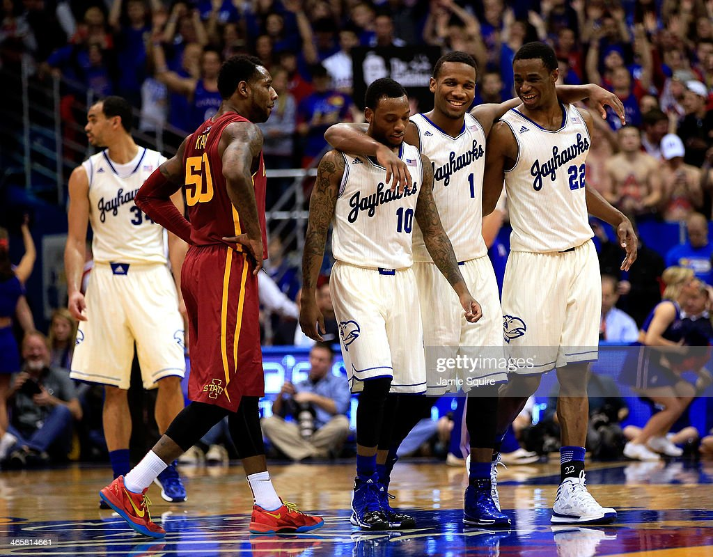Wayne Selden Jr #1 Naadir Tharpe and Andrew Wiggins of the Kansas Jayhawks walk onto the court after a timeout late in the game against the Iowa...