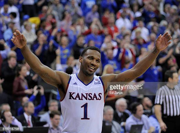 Wayne Selden Jr #1 of the Kansas Jayhawks celebrates after Kansas won the Big 12 Basketball Tournament in a 8171 win over the West Virginia...