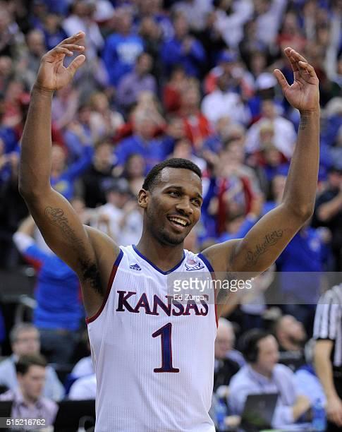 Wayne Selden Jr #1 of the Kansas Jayhawks celebrates after Kansas won the Big 12 Basketball Tournament in a 8171 win over the West Virginia...