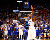 Wayne Selden Jr #1 of the Kansas Jayhawks celebrates during the final seconds of overtime in the game against the Kentucky Wildcats as Kansas...