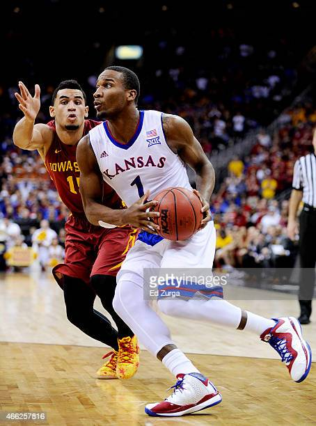 Wayne Selden Jr #1 of the Kansas Jayhawks drives against Naz Long of the Iowa State Cyclones in the second half during the championship game of the...