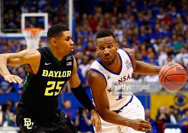Wayne Selden Jr #1 of the Kansas Jayhawks drives as Al Freeman of the Baylor Bears defends during the game at Allen Fieldhouse on January 2 2016 in...