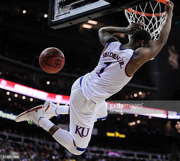 Wayne Selden Jr #1 of the Kansas Jayhawks dunks against the Baylor Bears in the second half during the semifinals of the Big 12 Basketball Tournament...