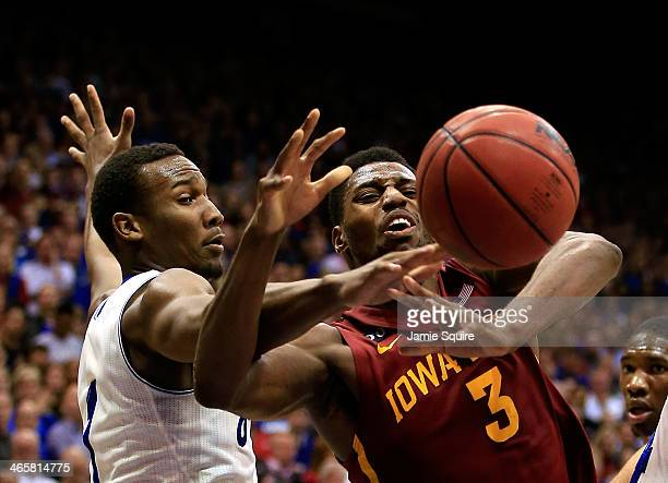 Wayne Selden Jr #1 of the Kansas Jayhawks knocks the ball away from Melvin Ejim of the Iowa State Cyclones during the game at Allen Fieldhouse on...