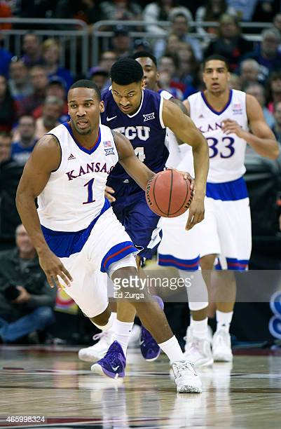 Wayne Selden Jr #1 of the Kansas Jayhawks makes a break up court against the TCU Horned Frogs during the quarterfinal round of the Big 12 basketball...