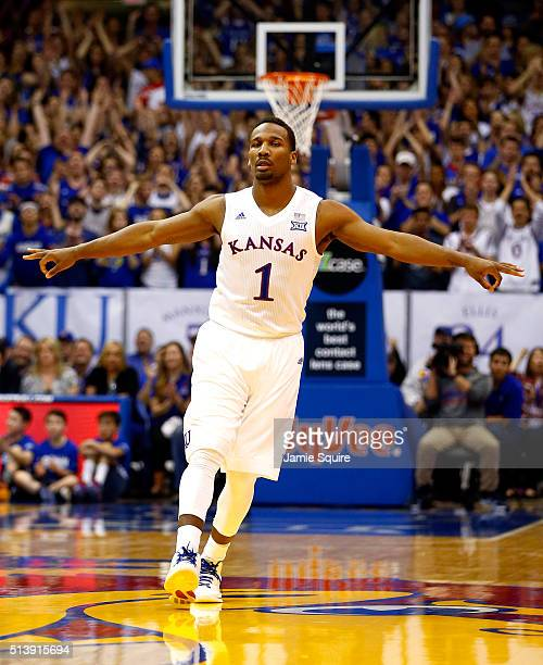 Wayne Selden Jr #1 of the Kansas Jayhawks reacts after making a threepointer during the game against the Iowa State Cyclones at Allen Fieldhouse on...
