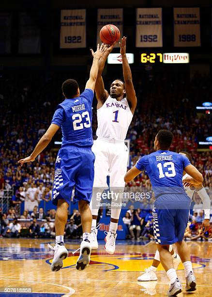 Wayne Selden Jr #1 of the Kansas Jayhawks shoots over Jamal Murray of the Kentucky Wildcats during the game at Allen Fieldhouse on January 30 2016 in...