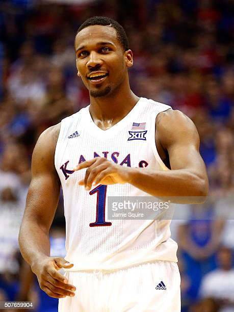 Wayne Selden Jr #1 of the Kansas Jayhawks smiles during the final seconds of overtime in the game against the Kentucky Wildcats as Kansas defeated...