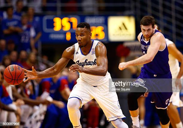 Wayne Selden Jr #1 of the Kansas Jayhawks steals the ball from Robert Champion of the Holy Cross Crusaders during the game at Allen Fieldhouse on...