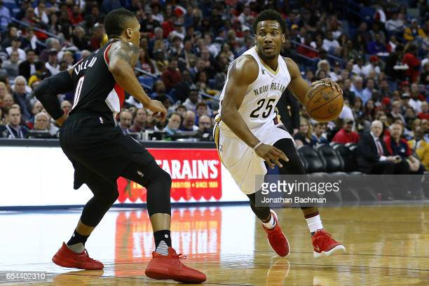 Wayne Selden Jr #25 of the New Orleans Pelicans drives against Damian Lillard of the Portland Trail Blazers during the second half of a game at the...