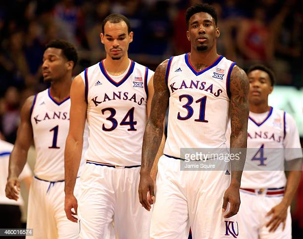 Wayne Seldin Jr #1 Perry Ellis Jamari Traylor and Devonte Graham walk onto the court after a timeout in the game against the Florida Gators at Allen...
